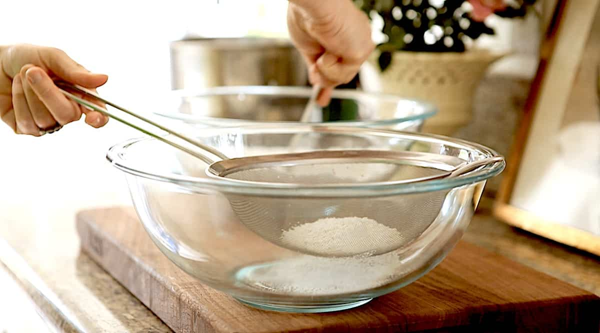sifting dry ingredients in a fine mesh sieve