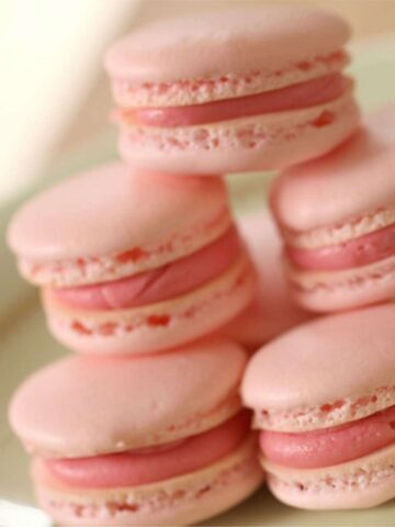 Close up of a stack of Pink French Macarons on a Plate