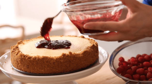 decorating a Raspberry Cheesecake Recipe with jam
