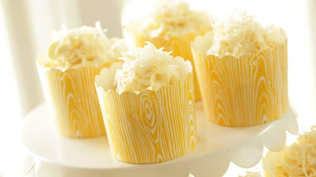 Banana Coconut Cupcakes served on a white cake stand