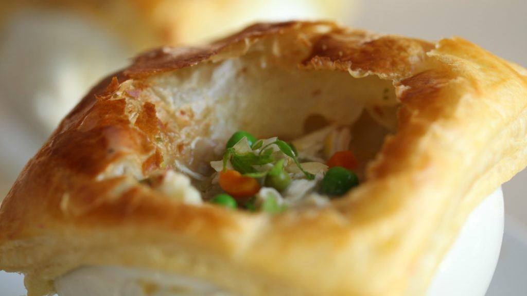 close up of Chicken Pot Pie Recipe with another individual chicken pot pie behind it