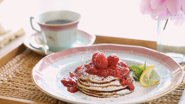 Lemon Ricotta Pancakes on plate with raspberry sauce