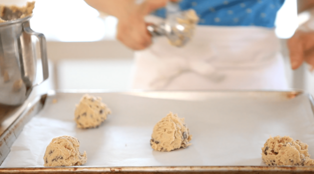 chocolate chip cookie dough scoop on cookie sheet