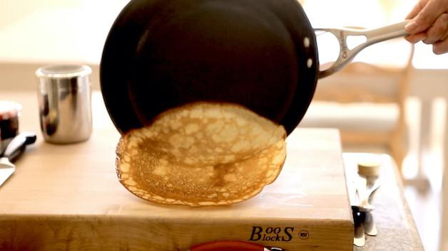 crepe sliding off pan onto board