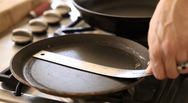 measuring a crepe pan with a ruler