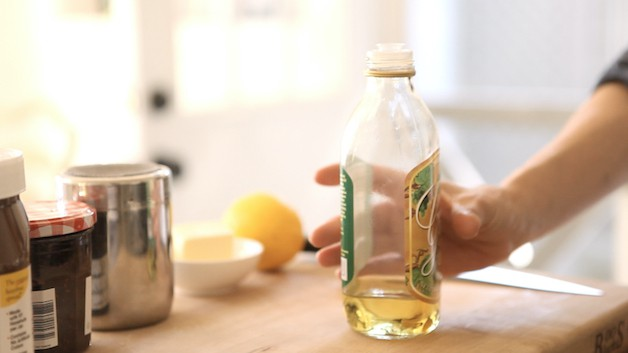 bottle of grapeseed oil on board with ingredients