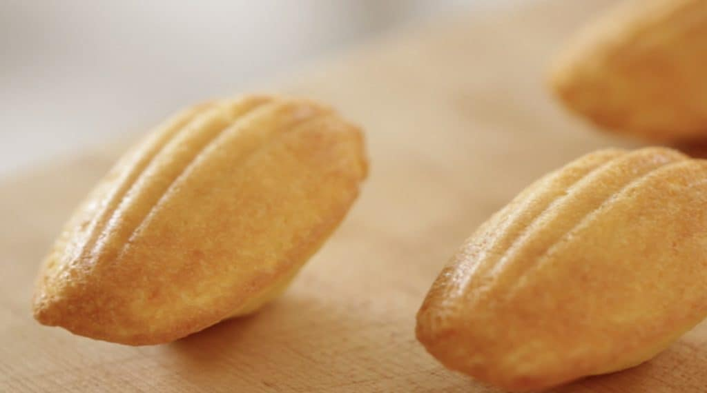 Scalloped detail of an Easy Madeleine Recipe lying on its hump