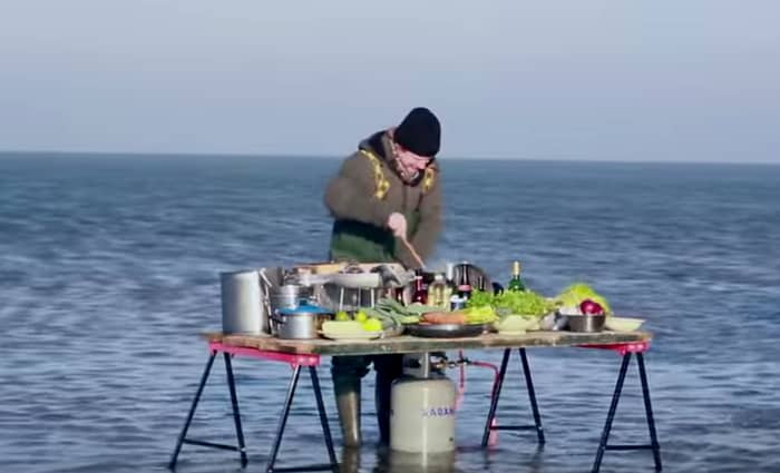 Bart Cooking on a table in the middle of a low tide ocean