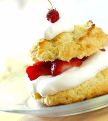 Strawberry Shortcake Biscuit on a plate with whippped cream and strawberries