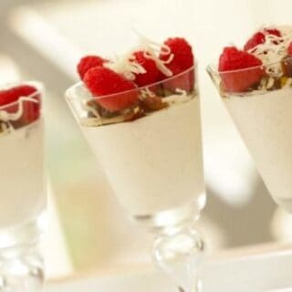 Greek Yogurt Panna Cotta Recipe served with fruit and nuts on top in tall glasses