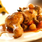 Coq au vin recipe on plate ready to be served