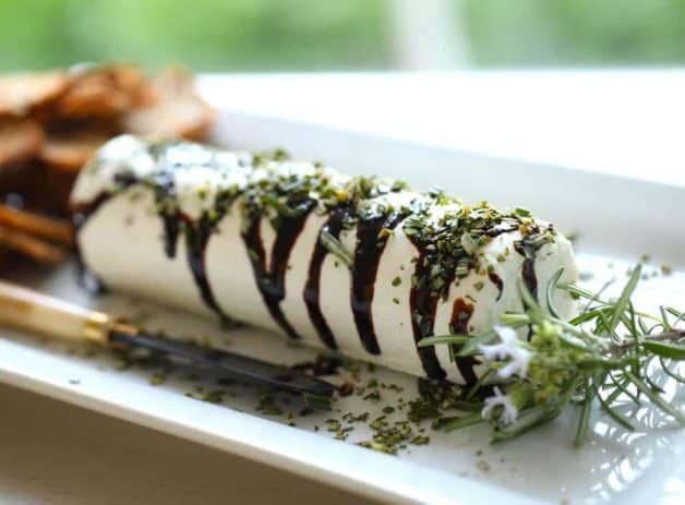 Goat Cheese drizzled with balsamic glaze and topped with chopped rosemary