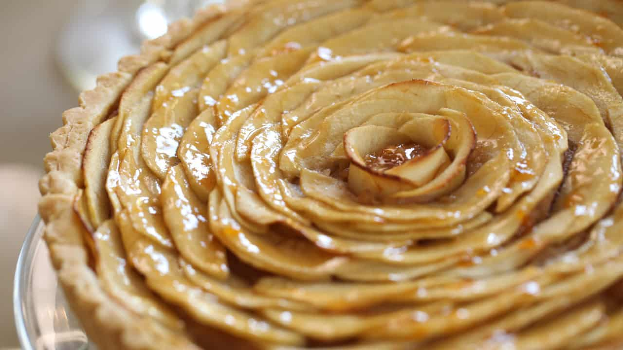 French Apple Tart Recipe baked and placed on cake stand