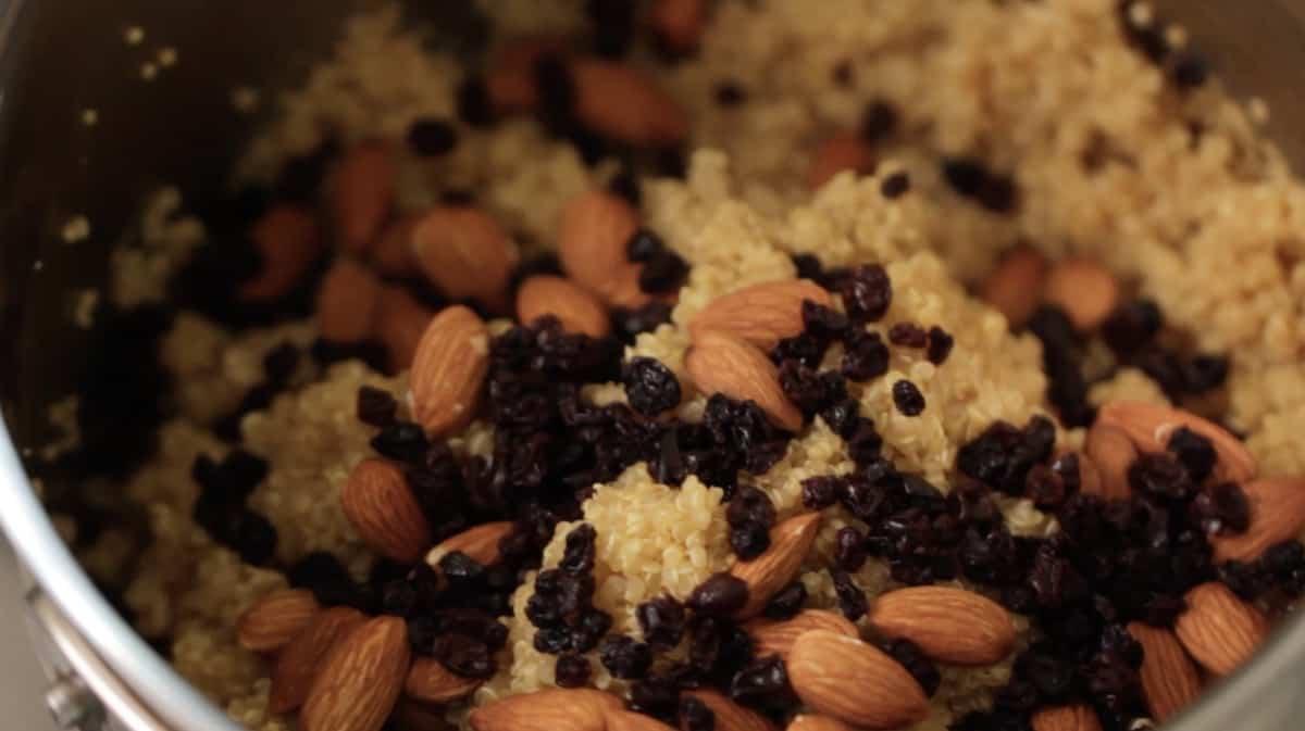 Quinoa in a pot with almonds and raisins