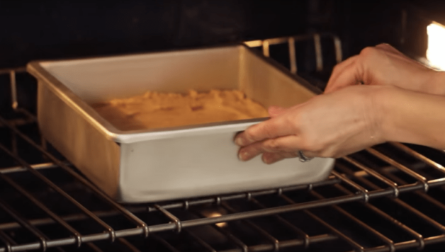 butterscotch blondie recipe being baked in a metal pan in the oven