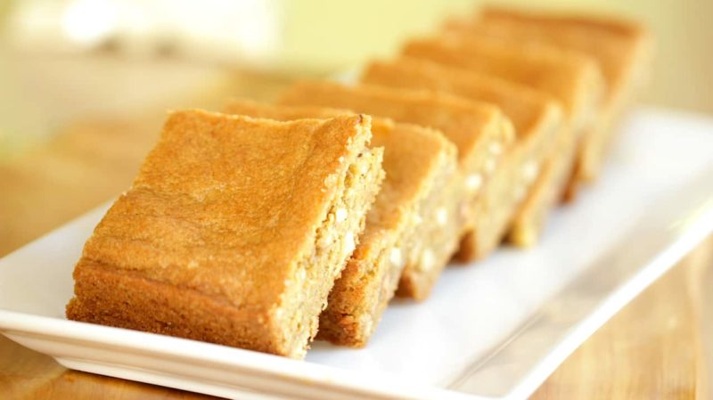 baked and cut butterscotch blondie recipe served on a white plate