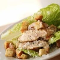 Easy Chicken Caesar Salad Recipe on a white plate