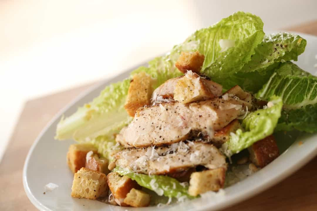 Easy Chicken Caesar Salad Recipe served on a white plate