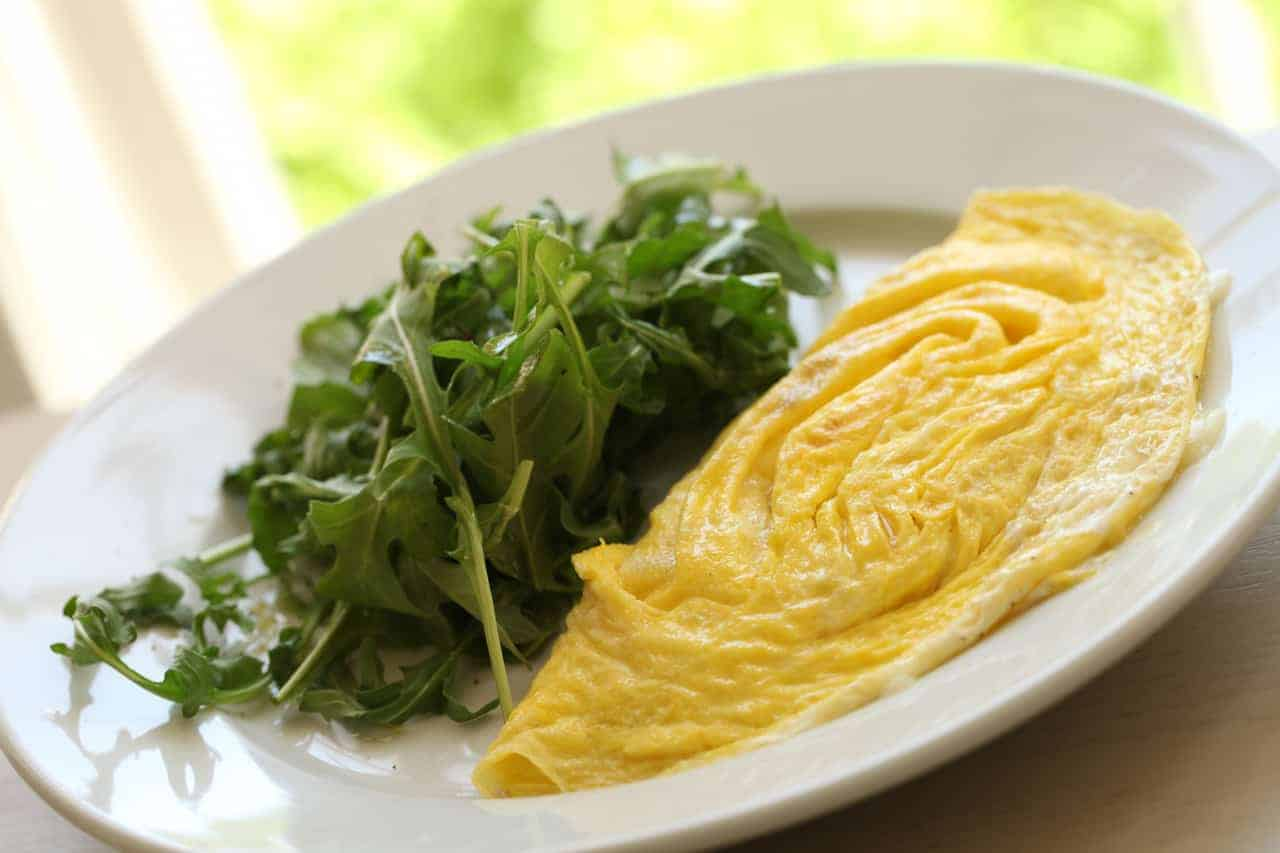 Omelette on a plate with Arugula Salad