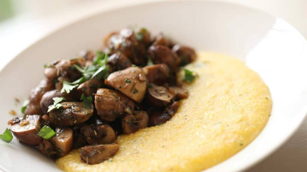 Mushroom Ragout and Creamy Polenta in a white bowl