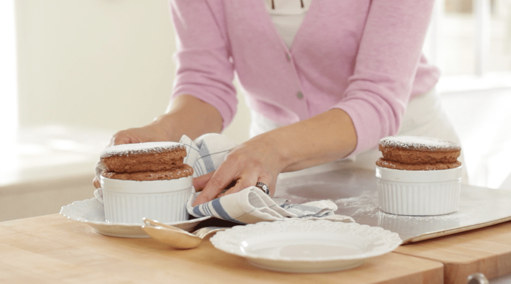 Serving a chocolate souffle right from the oven onto a plate