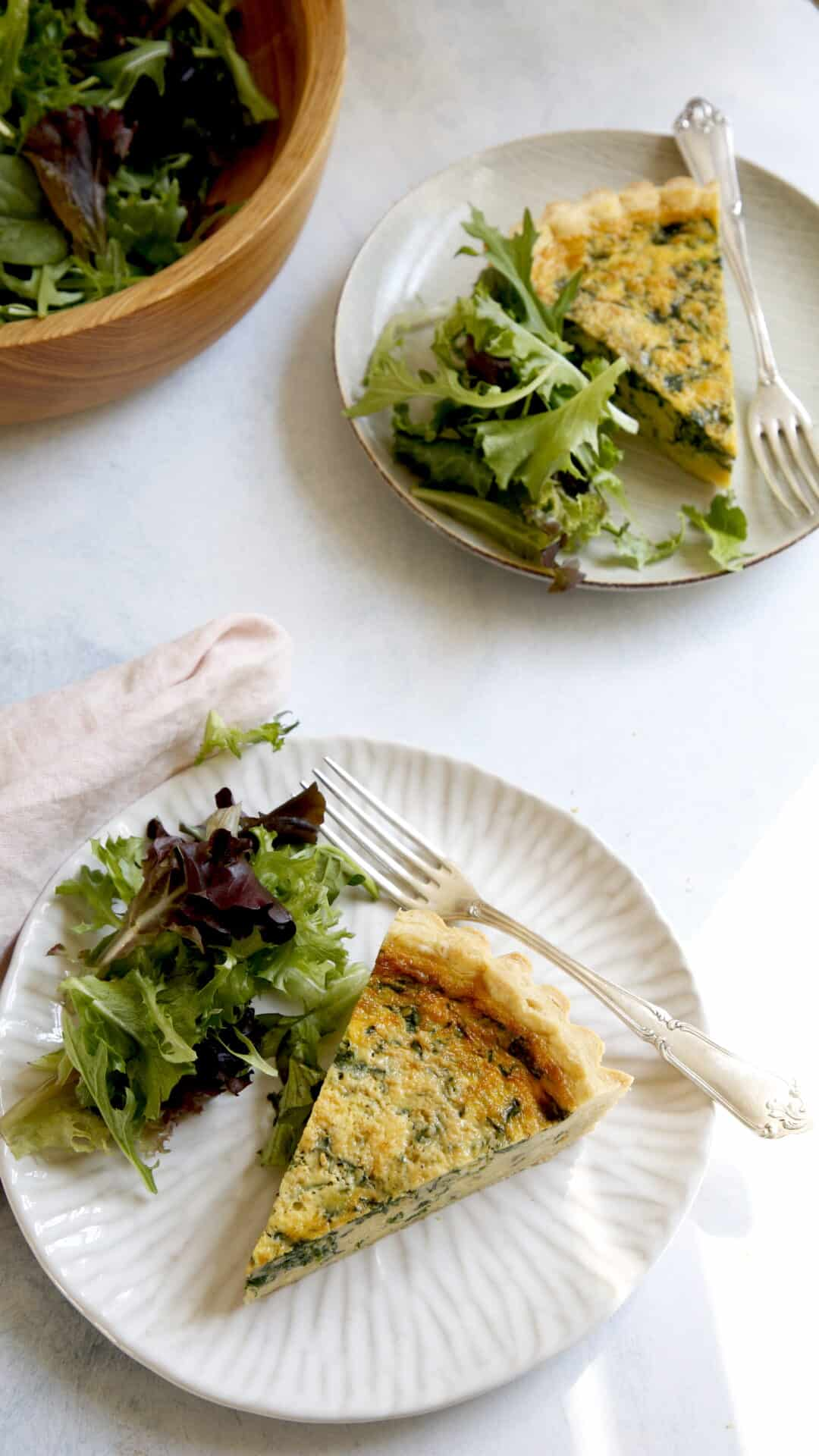 @ slices of Spinach Quiche on a plate with salad