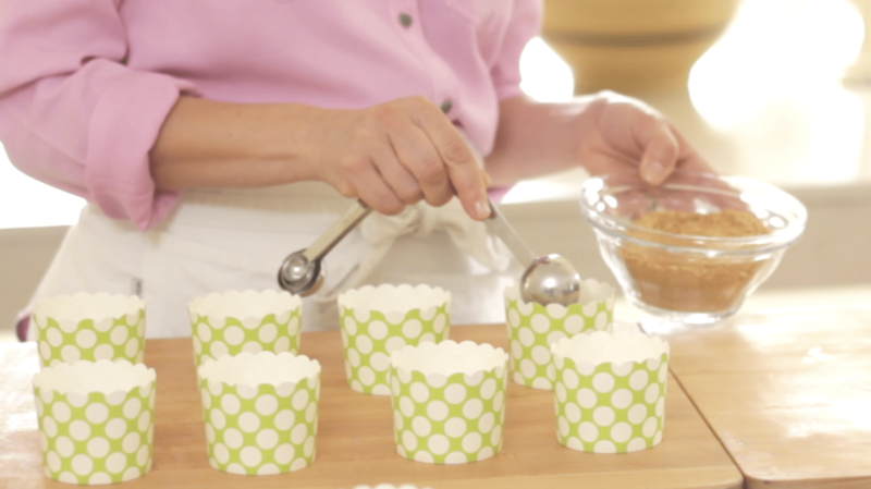 Key Lime Cups being made, crust being added to green cupcake liners