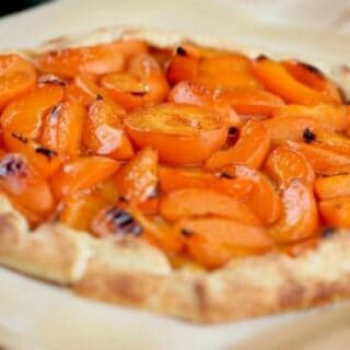 Apricot Galette Recipe baked and served on parchment paper on a wood surface