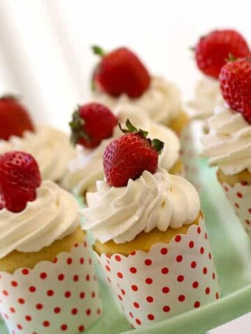 Easy Strawberry Shortcake Cupcakes recipe served on a green cake plate