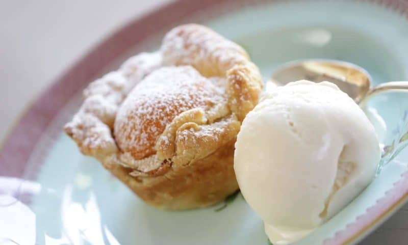Apricot Almond Tartlette with vanilla ice cream on a blue plate