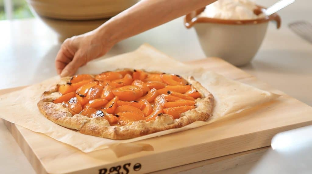 Apricot Galette on cutting board with whipped cream