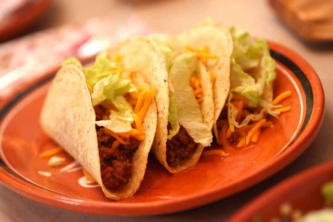 Slow Cooker Tacos on a terra cotta plate