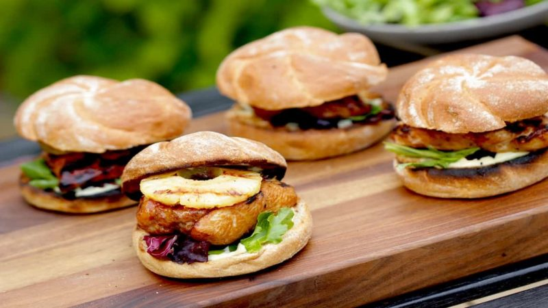 Grilled Chicken Teriyaki Sandwiches served outside on a wood board