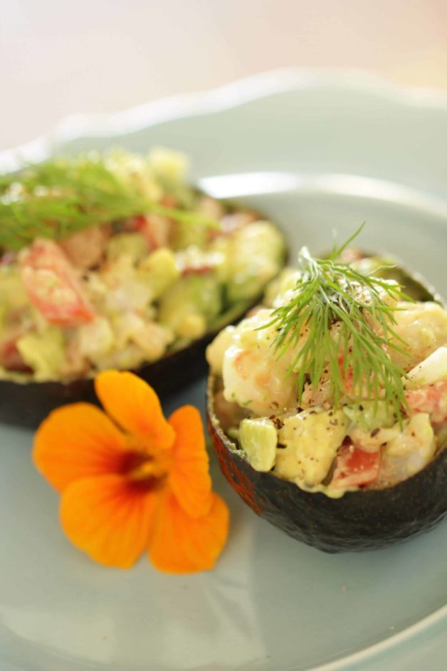 Avocado Shrimp Cup Recipe served on a light blue plate with an orange flower