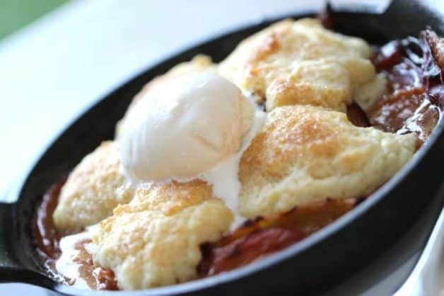 Peach Cobbler Recipe baked and served with vanilla ice cream