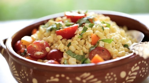 Easy Fresh Corn Salad Recipe in a terra cotta bowl