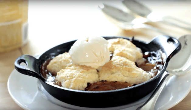 How to Make Peach Cobbler Recipe baked and served with vanilla ice cream scoop