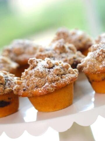 Coffee Cake Muffins served on a white scalloped cake stand