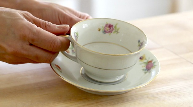 Floral Tea cup and saucer on a cutting board