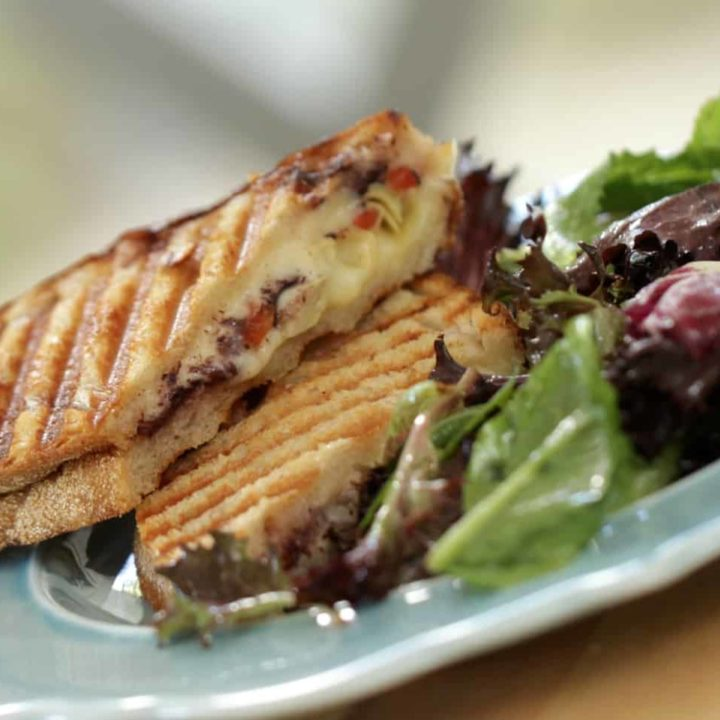 Vegetarian Panini Recipe served on a blue plate with salad