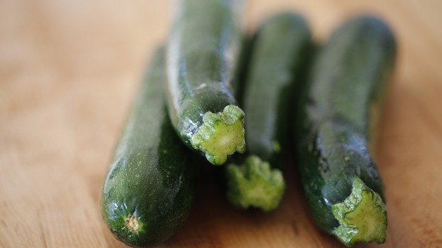 A close up of a stack of zucchini