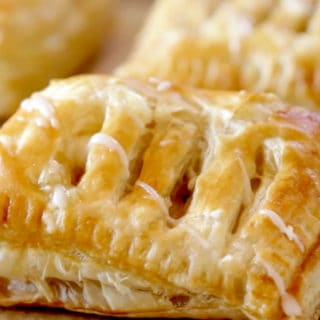 close up of an apple cinnamon pastry with a glaze on top
