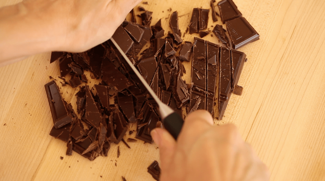 Chopping chocolate for a Chocolate Pot de Creme Recipe