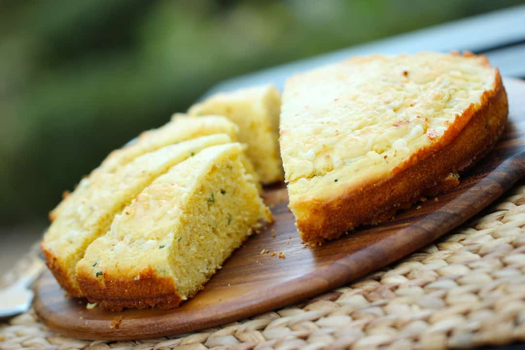 Cheesy Chivey Cornbread Recipe on a wooden board