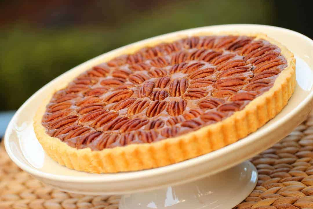 Chocolate Pecan Pie on a white cake stand