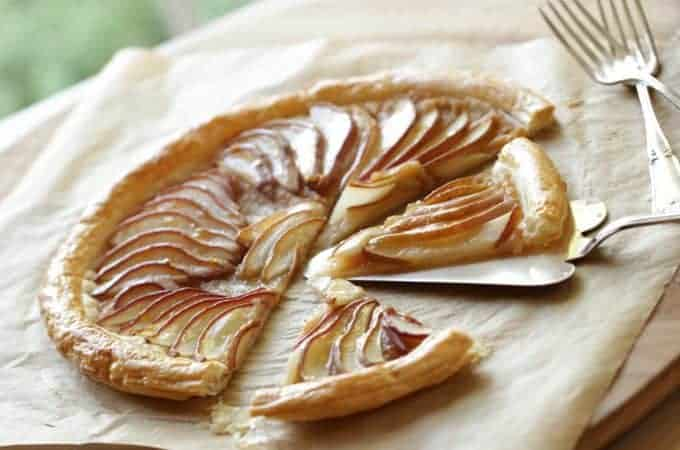 Easy Pear Tart Recipe sliced on parchment paper