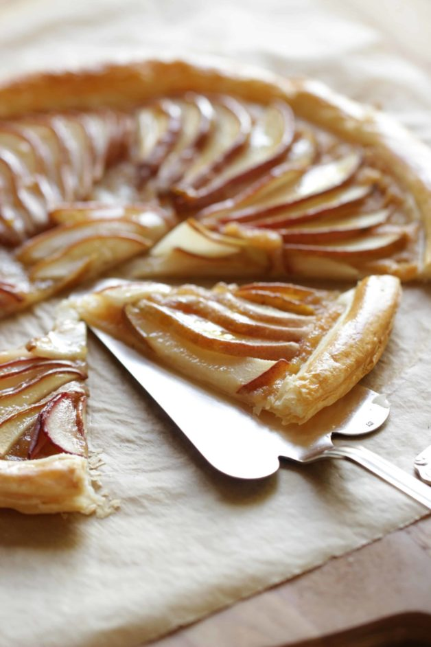 Easy Pear Tart Recipe with puff pastry on parchment paper on a cutting board