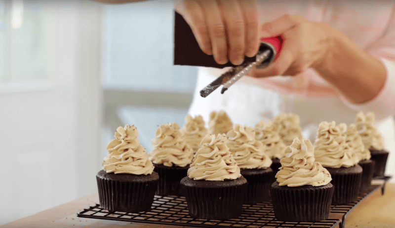 chocolate being grated on top of a Cafe Mocha Cupcake Recipe