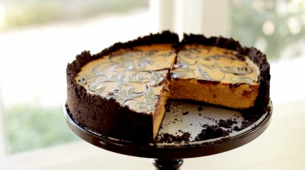Pumpkin Cheesecake with Chocolate Swirl with slices missing showing the inside
