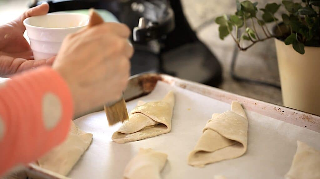 brushing puff pastry with egg wash